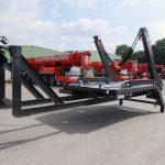 Absetzmulden mit Abrollrahmen auf Abrollkipper transportieren - Hüffermann